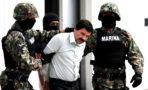 Mexican Navy soldiers escort Joaquin Guzman
