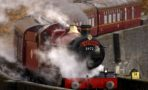 The Hogwart Express Steam Train crosses